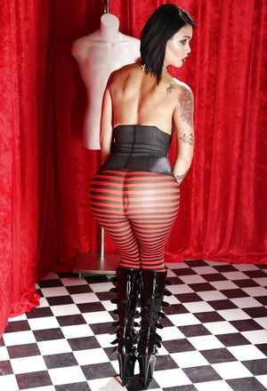 Fetish model Dana Vespoli posing topless in sexy stockings and boots
