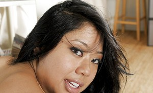 Lovely Asian bombshell Kya shows off her amazing pussy and tits