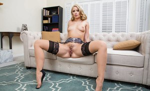Blonde wife Anikka Albrite striking sexy solo poses on couch in lingerie