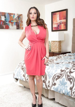 Buxom Euro mom Ava Addams getting undressed and exposing huge breasts