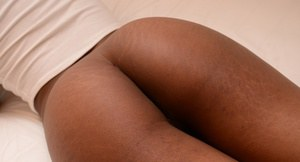 Young ebony first timer Lola flashing her pink panties on bed