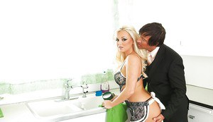 Sexy blonde housewife Bree Olsen giving a blowjob in the kitchen