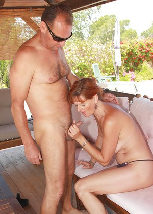 older redhead liddy fingers her mature pussy outdoors