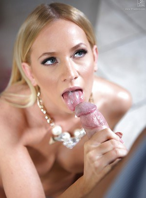 Blonde babe Kiara Lord giving a messy blowjob on her knees in kitchen