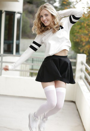 Blonde pornstar Karla Kush posing topless outdoors in schoolgirl uniform