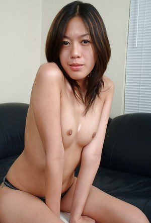 Barefoot Asian solo babe Starlingz striking sexy poses in lingerie