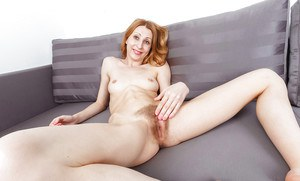 Aged redhead Kler spreading hairy pussy and butthole during solo poses