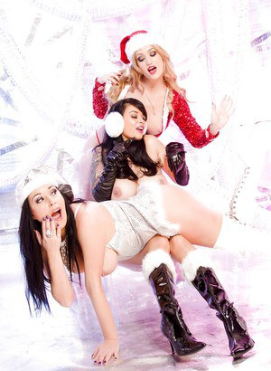 Busty lesbians go topless in boots for sexy Christmas photo shoot