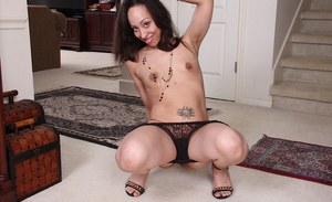 Petite older Latina lady Sasha Soja baring small tits and tattoos