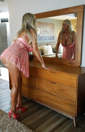 Chesty blond housewife Sandra Otterson strutting in lingerie and high heels