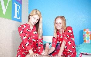 Clothed barely legal blonde girls giving a handjob together