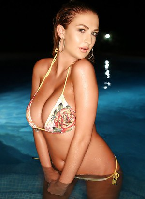 Busty solo model Ellis Attard posing for photos in swimming pool at night