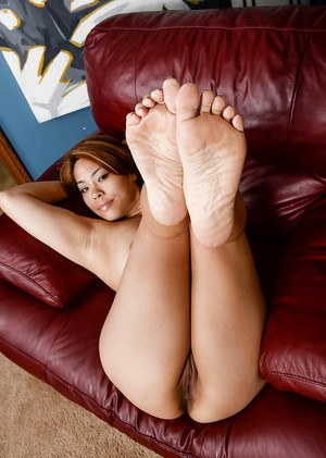 Asian solo babe Laci Hurst display painted toes and shaved pussy