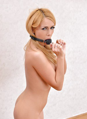Busty blonde slave Isabella Clark taking a dildo up her filthy asshole