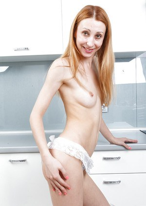 Older redhead model Kler undressing to reveal her hairy pussy