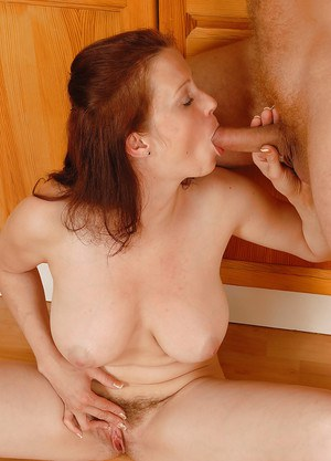 Chesty first timer Carol giving a blowjob to hubby in kitchen