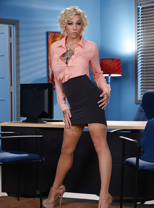 Short haired blonde secretary Harlow Harrison exposing nice melons at work