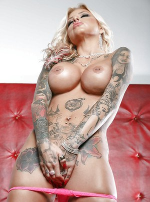 Tattooed MILF Britney Shannon showing off heavily inked body and big tits