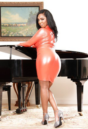Big boobed black babe in tight fitting dress lets big black tits loose