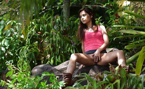 Petite teen babe Kelly Kitty pulling pink panties down in forest