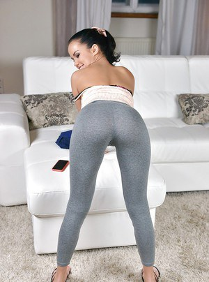 Young hottie Megan Rain removing yoga pants to expose puffy pussy