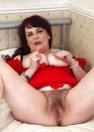 Experienced Euro lady Christina X sliding undies over ass to reveal beaver
