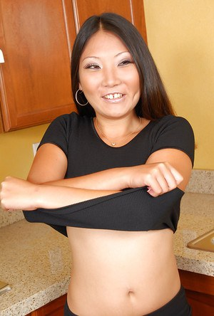 Asian first timer Miki removing business clothes for nude poses