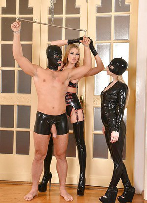 Latex clad dommes Lucy Heart and Nesty for masked man to eat ass