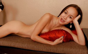 Barely legal Asian spinner Amai Liu posing fully clothed before stripping