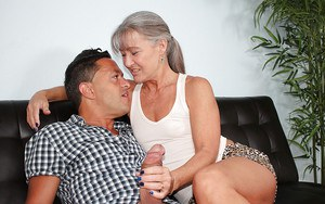 Fully clothed over 40 cougar jerking fat cock until happy ending