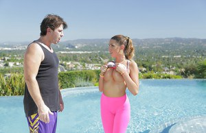 Teen babe August Ames undressing outdoors beside swimming pool