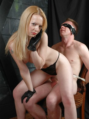 Dominant wife Rachel attends to her naked and blindfolded husband