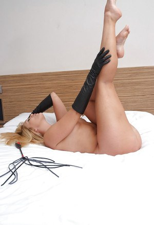 Naked blonde babe Shay fondling big tits with black leather gloves
