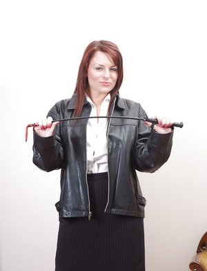 Busty redhead in leather bomber jacket unleashes large all natural tits