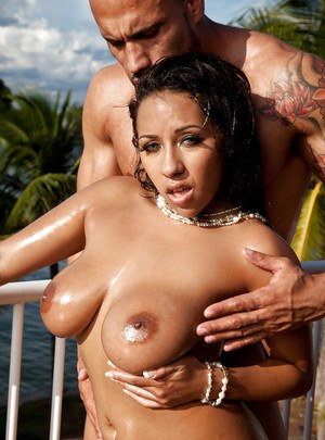 Ebony chick Priya Price and her big oiled boobs take hardcore fuck outdoors