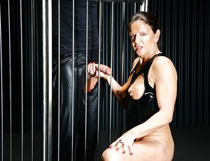 Older UK chick Lady Sarah jacking off a fat cock in jail cell