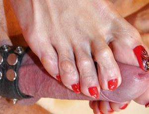 Experienced UK foot model Lady Sarah jacking cock for cumshot on toes