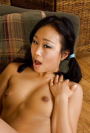 Asian first timer Bella posing for topless photo in pigtails