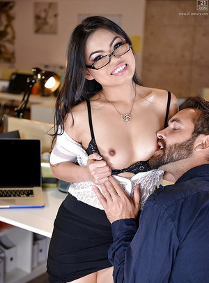Sexy Asian secretary Cindy Starfall giving a blowjob to coworker