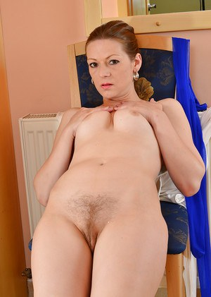 Mature lady Mischelle removes pantyhose to spread hairy pussy