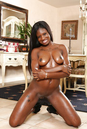 Chunky ebony chick Kay Love showing off oiled booty in thong and boots