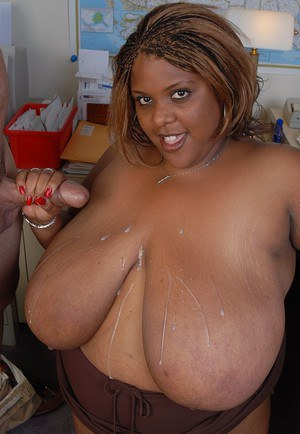 Chesty black fatty Minxx taking cumshot on massive black breasts