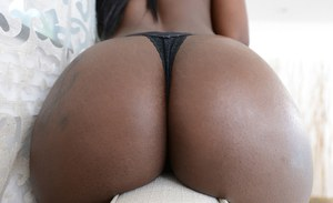 Hot black chick Kay Love strikes sexy poses outdoors in stockings and thong