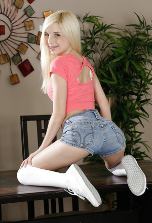 Blonde pornstar Piper Perri strutting non nude in white over the knee socks