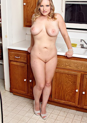 Chubby blonde housewife Vicky Vixen spreading her pussy in kitchen