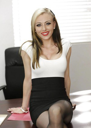 Blond pornstar Jeannie Marie Sullivan strips off business clothes for nudes