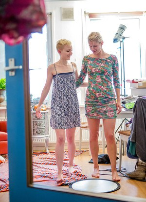 Blonde lesbians Lana S and Liese getting dressed after lesbian sex