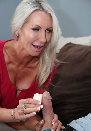Older blonde MILF Emma Starr seduces a younger man with blowjob