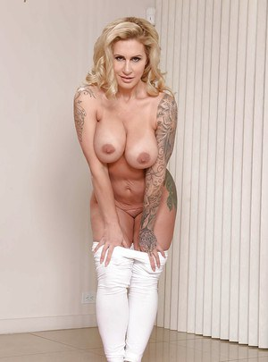 Tattooed blonde babe Ryan Conner sliding pants over nice ass