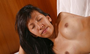 Asian first timer Linny showing off belly piercing and small tits